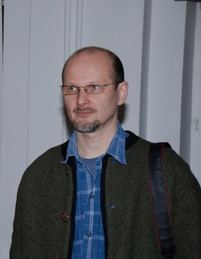Portret Igora Yelpatova, malarza warszawskich pejzaży miejskich.